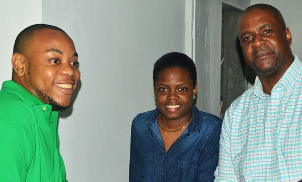 Fahie (right) strikes a pose with VIP members at the 'Mix and Mingle' event