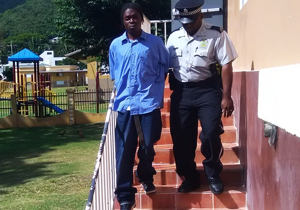 Arian Fahie being escorted from court