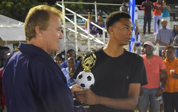 Phillip Jules receives his Young Player Award from Andy Bickerton, BVIFA President