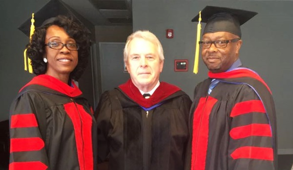 Pastor couple earns third degree together