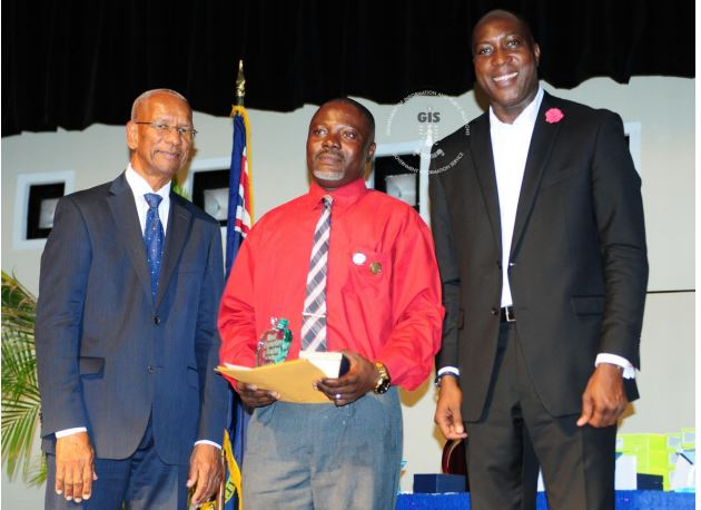 Honourable Dr. D. Orlando Smith, Premier and Minister of Finance, Teacher of the Year – Secondary, Zakaria Yunusah (Elmore Stoutt High School) and Honourable Myron Walwyn, Minister for Education and Culture.