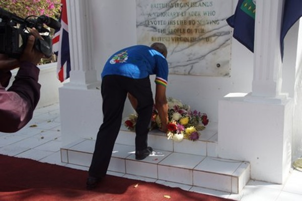 Premier Dr D Orlando Smith lays a wreath in honour of the territory's first chief minister Hamilton Lavity Stoutt. PHOTO CREDIT: Andre 'Shadow' Dawson/BVI News Online