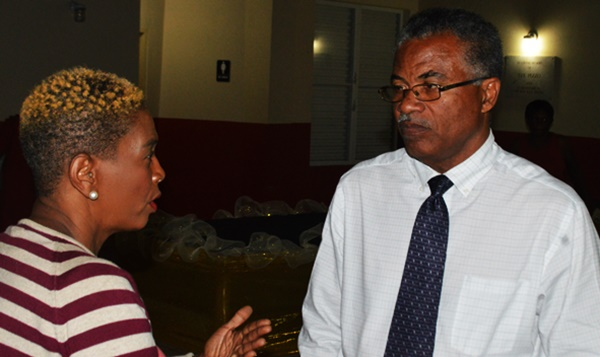 Dr Hubert O'Neal speaks with a resident after the meeting