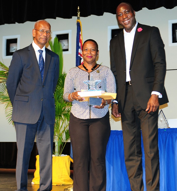 Assistant Principal of the Year Keisha King along with Premier Dr D Orlando Smith (left) and Minister of Education Myron Walwyn. Photo credit: Ronnielle Frazer/Government Information Services