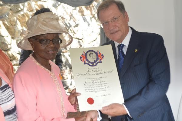 Rubena Matthias-Fraser receiving her award from Governor John Duncan