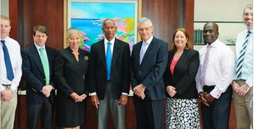 Premier Smith with BVI Finance Limited's Board of Directors: Kedrick Malone, Ryan Geluk, Kenneth Morgan, Jonathan Bailey, Helene Lewis, Rachel McDonald, Claire Abrehart and Robert Briant (from left to right). Not seen: Brodrick Penn, Peter Tarn, Vanessa King and Rachel McDonald.