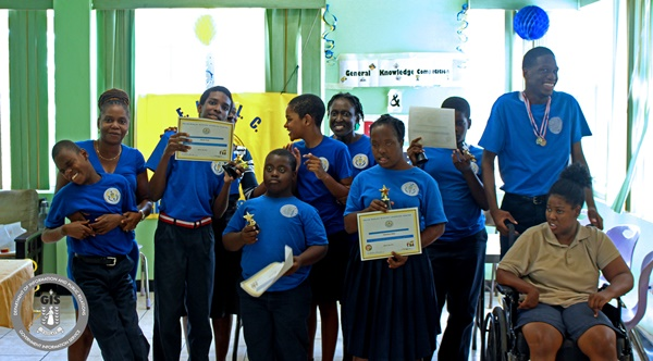 Students from the winning house, Blue House, receiving their awards. (Photo Credit: GIS/Franklyn Skerritt)