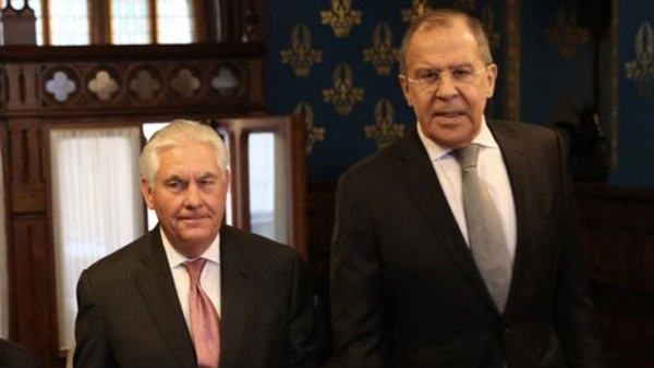 """Mr Lavrov (R) said he had questions for Mr Tillerson over the """"very ambiguous"""" US policies"""