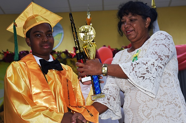 Male graduates top class of 18